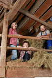 Family on a haystack Stock Images