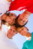 Family heads together. Happy family heads together on blue sky royalty free stock photos