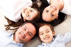 Family with heads together Royalty Free Stock Images