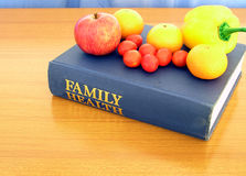Family Health. An apple a day keeps the doctor away; five pieces of fruit keeps cancer at bay. Background for health products Stock Photography