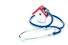 Family health concept, house model with stethoscope Stock Images