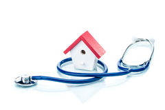 Family health concept, house model with stethoscope Royalty Free Stock Image