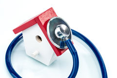 Family health concept, house model with stethoscope Royalty Free Stock Photos