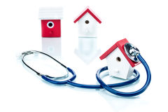 Family health concept, house model with stethoscope Stock Photo
