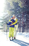 Family healthy lifestyle! Mother and son child go skiing in winter forest Stock Photo