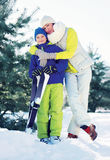 Family healthy lifestyle! Mother and son skiing in the forest Stock Photo