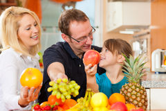 Family and healthy nutrition. Family (mother, father and child) with lots of fruits for breakfast food, this is healthy nutrition royalty free stock photos