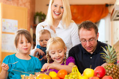 Family and healthy nutrition. Family (mother, father and children) with lots of fruits for breakfast food, this is healthy nutrition royalty free stock image