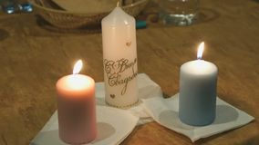 Family hearth of three burning candles. Close-up stock video footage