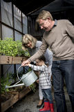 Family Helping Teaching Kid Gardening Royalty Free Stock Photo