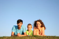 Family on herb. Under blue sky lie royalty free stock photography