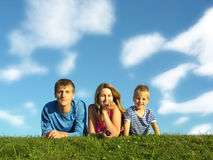 Family on herb under blue sky. With clouds royalty free stock photos