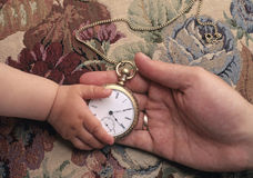 Family Heritage. Father giving child antique pocket watch Royalty Free Stock Photography