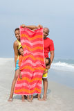 Family hiding behind towel Royalty Free Stock Photos