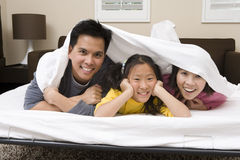 Family Hiding Under The Blanket Royalty Free Stock Photos