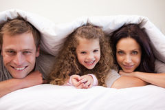 Family hiding under their blanket Royalty Free Stock Photo
