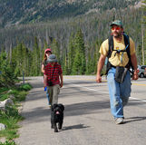 Family hike. A family and their dog coming back from a hike Royalty Free Stock Image