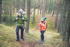 Family on a hike in the forest with baby in child carrier Royalty Free Stock Photos