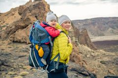 Family hike, mother with baby in backpack Royalty Free Stock Photo