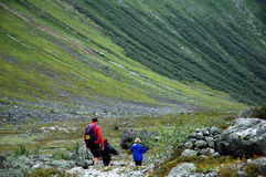 Family on a hike in the mountains. Nikon D70, mountain landscape scene in Norway stock images