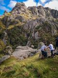 Family hike through the mountains under a blue sky. stock images