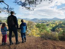 Family hike in autumn forest in Rheinland Pfalz. Family hike in natural autumn forest in Rheinland Pfalz Royalty Free Stock Photo