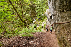 Family of hikers in a canyon Stock Photos