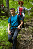 Family of hikers walking on a mountain trail Stock Photography