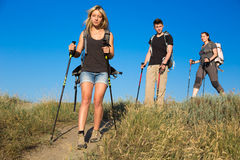 Family of hikers walks on clay path Stock Image