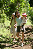 Family hiking. In a tropical forest stock image