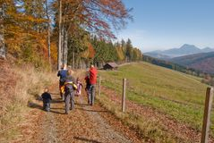 Family hiking in autumn stock photography
