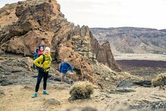 Family hiking with baby boy travelling in backpack Stock Photography