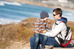 Family hiking at the beach Royalty Free Stock Images