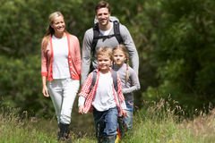 Family Hiking In Countryside. Smiling stock image