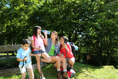 Family on a hiking day drinking water Stock Photo