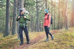Family hiking in the forest with baby in child carrier Royalty Free Stock Photography
