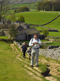 Family hiking on hill in English countryside stock photo
