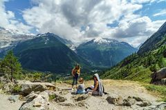 Family hiking in mountains, Alps, France, sunny day stock photo