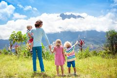 Family hiking in mountains and jungle Royalty Free Stock Photo
