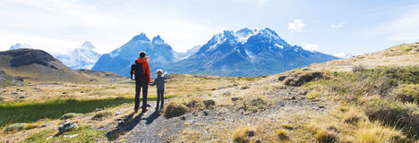 Family hiking in patagonia. Panorama view of family enjoying active vacation in patagonia and hiking in torres del paine national park, chile stock images