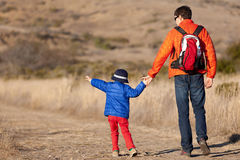 Family hiking. Positive family of two hiking together royalty free stock photo