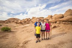 Family hiking together among desert red rock formations at Goblin Valley Royalty Free Stock Photos