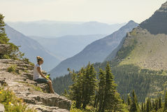 Woman overlooking the beautiful Rocky Mountains Royalty Free Stock Photos