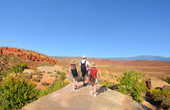 Family on hiking trip in beautiful mountains. Stock Photo