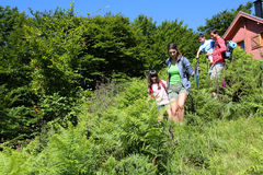 Family on a hiking trip. Family on a hiking day going down hill Stock Photography