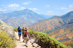 Family on hiking trip in high mountains. People on vacation. Family with backpacks on hiking trip , High mountains landscape with cloudy sky. Kings Canyon royalty free stock image