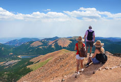 Family on a hiking trip in the mountains. File name:People standing on top of mountain rock. Family looking at beautiful summer mountains landscape,from Pikes Royalty Free Stock Photography