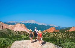 Family hiking on vacation trip in Colorado. Beautiful red mountains and green hills in Colorado. Garden of the Gods, Colorado Springs, Colorado, USA royalty free stock photo