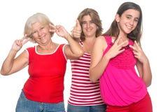 Family of hispanic women having fun. Having fun isolated on white Stock Photo
