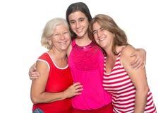 Family of hispanic women isolated on white. Three generations of hispanic women isolated on a white background Stock Images